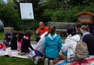 BC Lion reading at the Little Libraries Launch Event